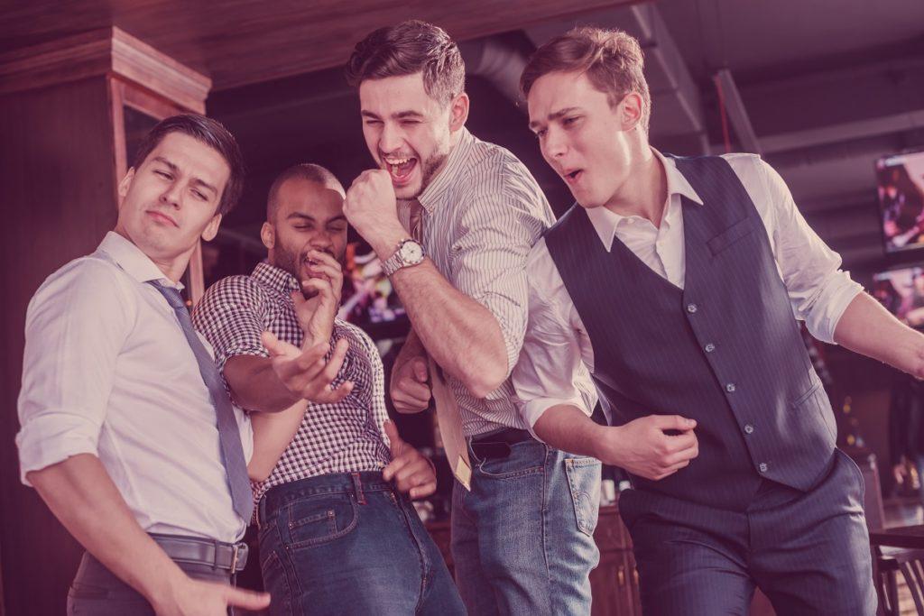 men partying and singing