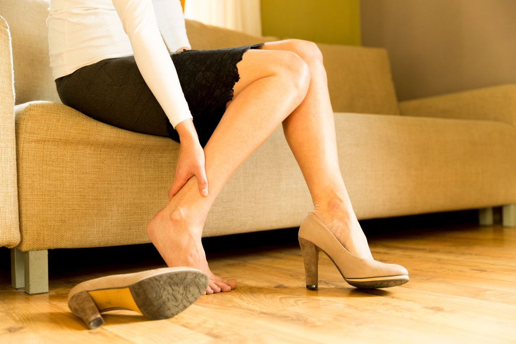 woman suffering from heel pain