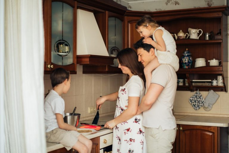 family making breakfast together