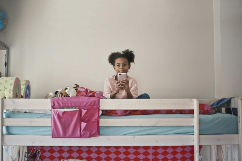 child in loft bed