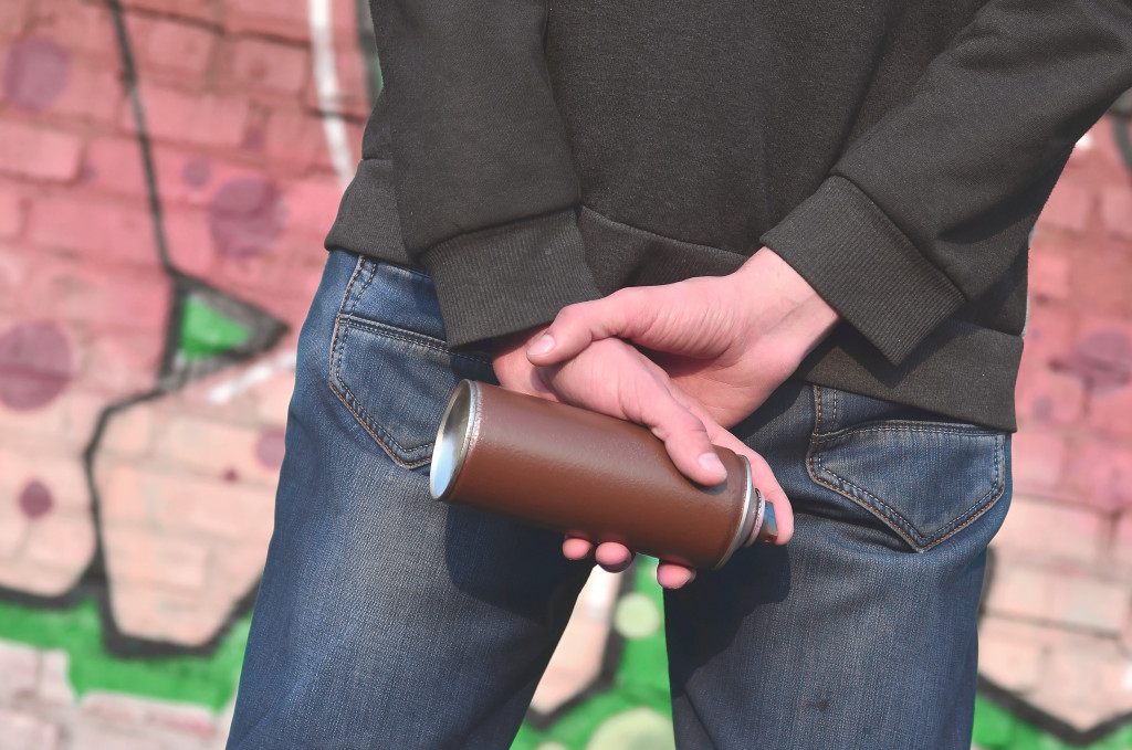 teenager holding a spray can