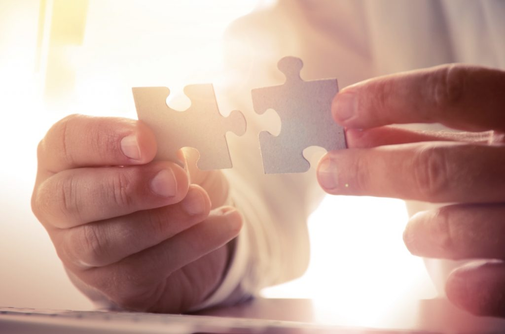 man holding puzzle pieces